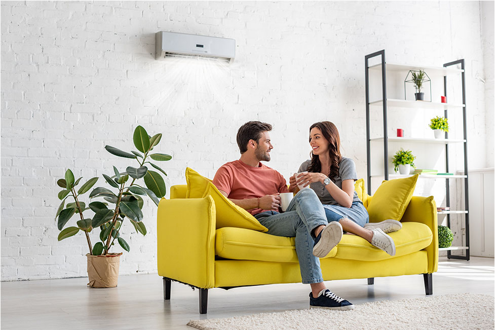 Man and woman enjoying indoors with a multi head split system on the wall