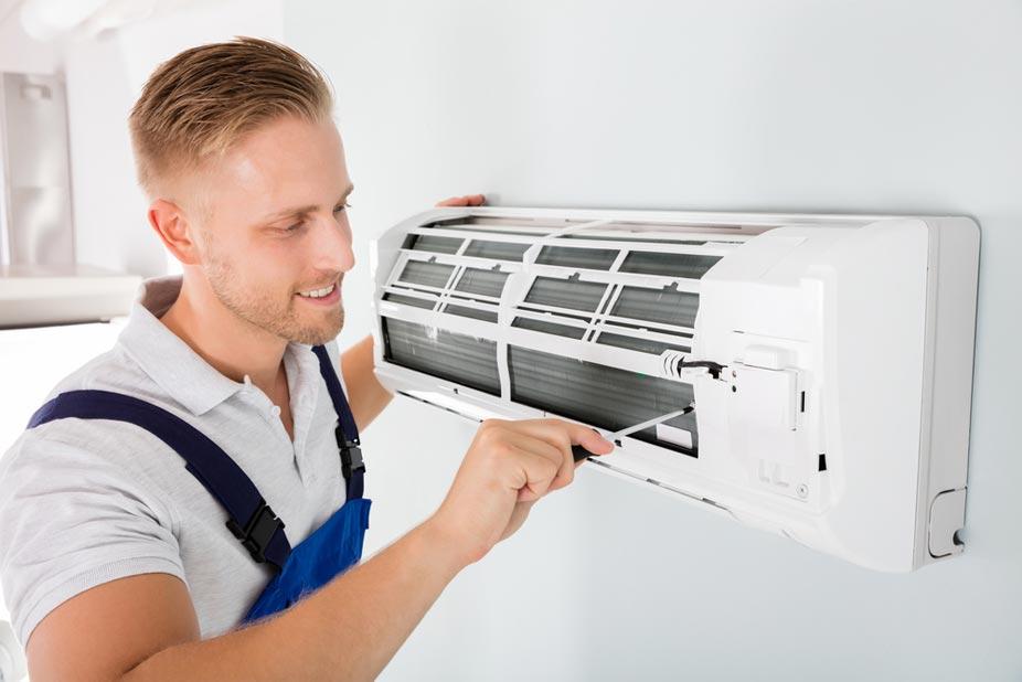 Man doing split system air conditioner repair